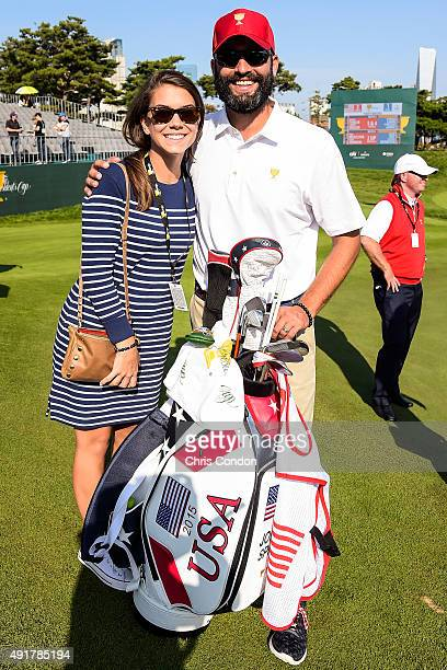 Annie Verret girlfriend of Jordan Spieth of Team USA and Spieth's caddie Michael Greller pose for a photo during the first round of The Presidents...