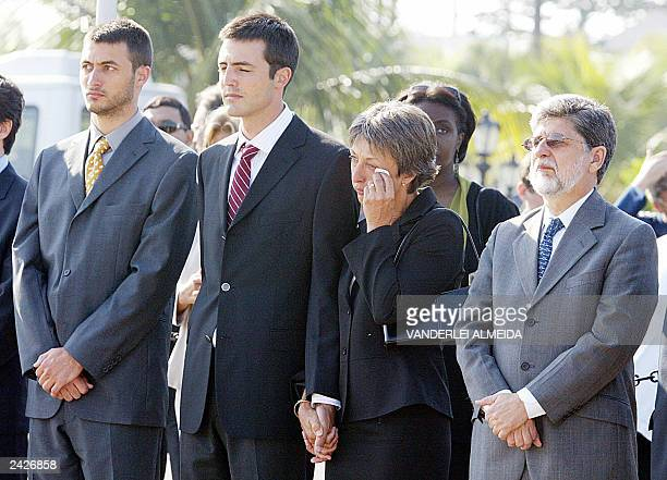 Annie Vieira de Mello widow of Brazilian UN representant in Baghdad Sergio Vieira de Mello cries beside his sons Laurent and Adrian while Brazilian...