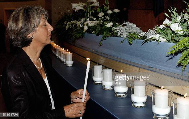 Annie Viera De Mello, widow of late UN's high commissioner for human rights Vieira de Mello sets alight candles during a ceremony held at the United...