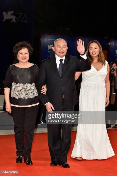 Annie Woo Ngau Chunlung John Woo and Angeles Woo walk the red carpet ahead of the 'Manhunt ' screening during the 74th Venice Film Festival at Sala...
