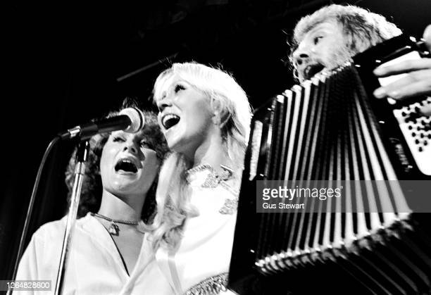 Anni-Frid Lyngstad, Agnetha Faltskog and Benny Andersson of ABBA perform on stage at the Royal Albert Hall, London, England, on February 14th, 1977.