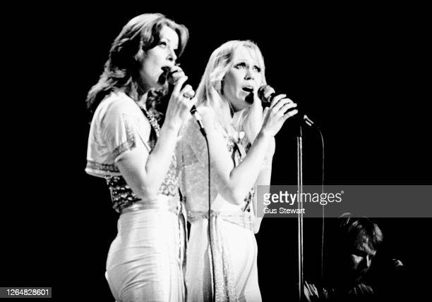 Anni-Frid Lyngstad and Agnetha Faltskog of ABBA perform on stage at the Royal Albert Hall, London, England, on February 14th, 1977.