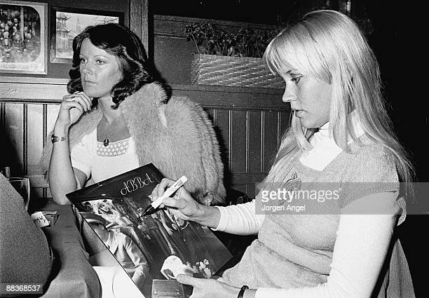 AnniFrid Lyngstad and Agnetha Fältskog of pop group Abba signing copies of their third album 'Abba' in May 1975 in Copenhagen Denmark