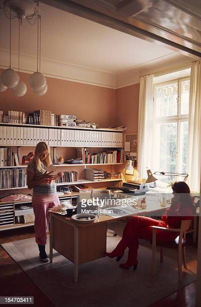 AnniFrid Lyngstad CALLING seat has an office with Agnetha Faltskog standing reading something