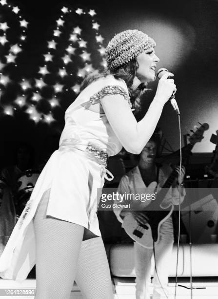 Anni-Frid Lyngstad of ABBA performs on stage at the Royal Albert Hall, London, England, on February 14th, 1977.
