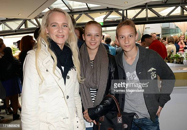 Annik Wecker and her son Tamino and sister Kimsy Berlin attend the 'Sommerfest der Agenturen' during the Munich Film Festival 2013 at Hugo'S...
