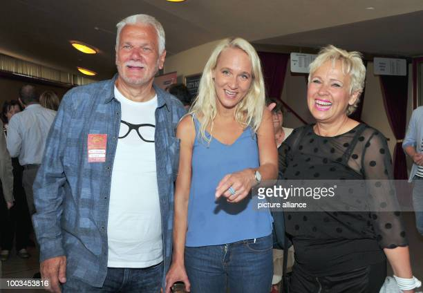 Annik Wecker wife of singersongwriter Konstantin Wecker and her parents Reinhard Berlin and Hedda Berlin laugh before the befinninf of Konstantin...