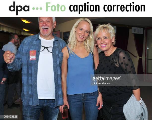 Annik Wecker wife of singersongwriter Konstantin Wecker and her parents Reinhard Berlin and Hedda Berlin laugh before the befinning of Konstantin...