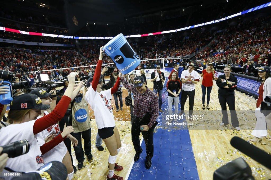 Annika Albrecht (17) of the University of Nebraska laughs after spraying Nebraska head coach John Cook with water following the Division I Women's Volleyball Championship held at Sprint Center on December 16, 2017 in Kansas City, Missouri.