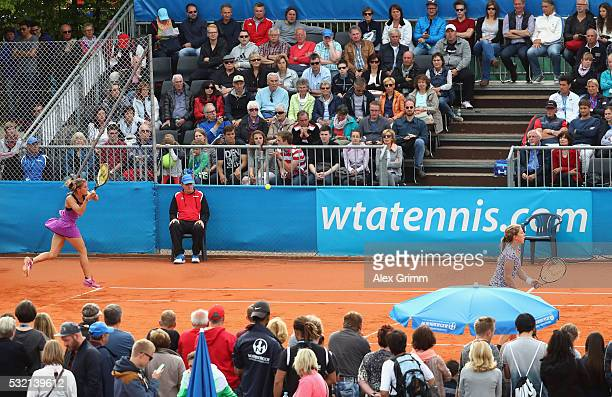 Annika Beck and Anna-Lena Friedsam of Germany play their doubles match against Chin-Wei Chan of Taiwan and Demi Schuurs of Netherlands during day...