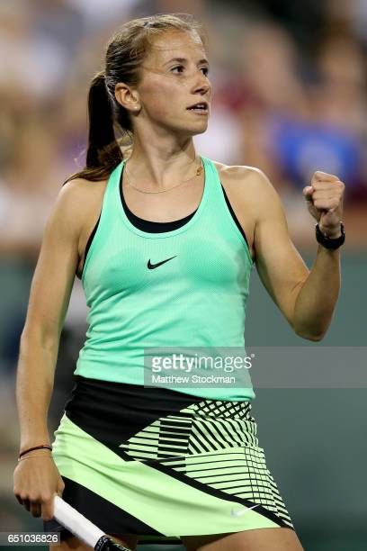 Annika Beck of Germany celebrates a point against Eugenie Bouchard of Canada during the BNP Paribas Open at the Indian Wells Tennis Garden on March 9...