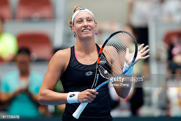 Annika Beck of Germany celebrates her win over Belinda Bencic of Switzerland during the Women's singles first round match on day one of the 2016...