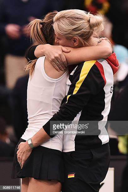 Annika Beck of Germany celebrates victory with team captain Barbara Rittner after her match against Timea Bacsinszky of Switzerland on Day 2 of the...