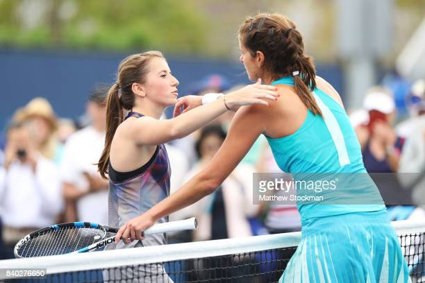 Annika Beck of Germany congratulates Julia Goerges of Germany on her victory after their first round Women's Singles match on Day One of the 2017 US...