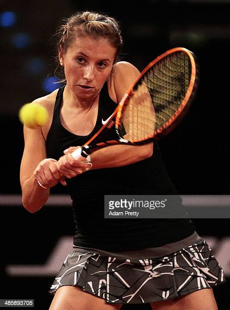 Annika Beck of Germany hits a backhand during her first round match against of the Katerina Vankova of the Czech Republic on day one of the Porsche...