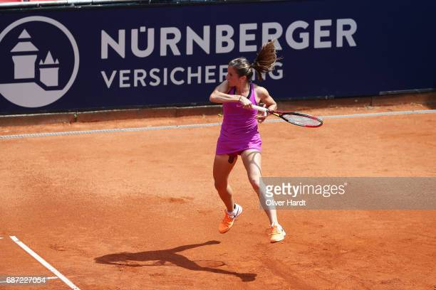 Annika Beck of Germany in action against Lena Rueffer of Germany in the first round during the WTA Nuernberger Versicherungscup on May 23 2017 in...