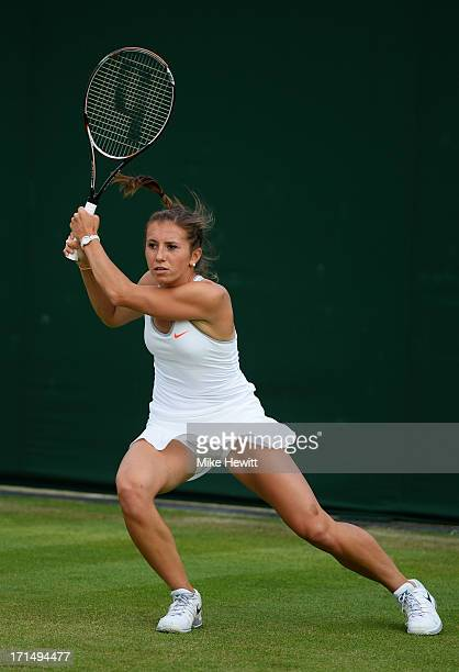 Annika Beck of Germany plays a backhand during her Ladies' Singles first round match against Nina Bratchikova of Russia on day two of the Wimbledon...