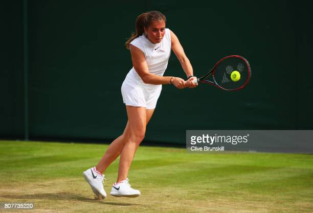 Annika Beck of Germany plays a backhand during the Ladies Singles first round match against Polona Hercog of Slovenia on day two of the Wimbledon...