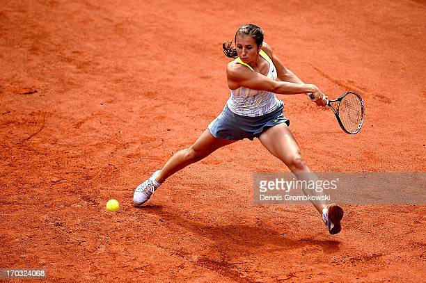 Annika Beck of Germany plays a backhand in her first round match against Nina Bratchikova of Russia during day four of the Nuernberger Insurance Cup...