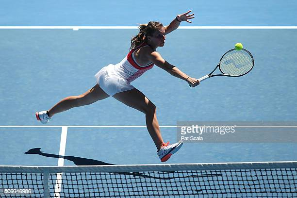 Annika Beck of Germany plays a backhand in her fourth round match against Angelique Kerber of Germany during day eight of the 2016 Australian Open at...