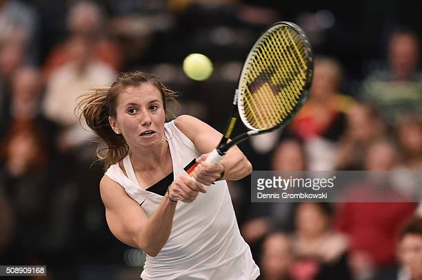 Annika Beck of Germany plays a backhand in her match against Timea Bacsinszky of Switzerland on Day 2 of the 2016 FedCup World Group Round 1 match...