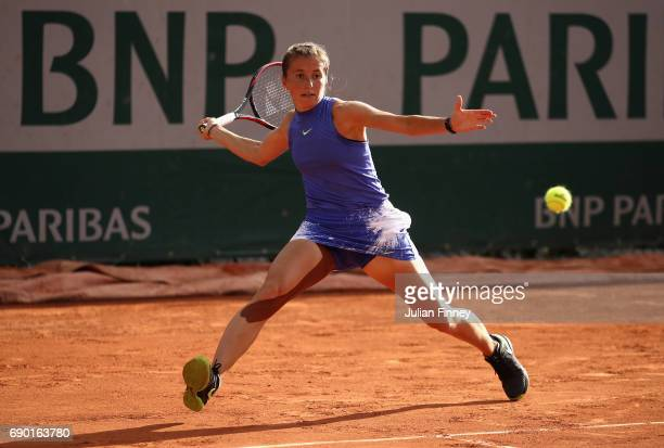 Annika Beck of Germany plays a forehand during the ladies singles first round match against Anastasija Sevastova of Latvia on day three of the 2017...