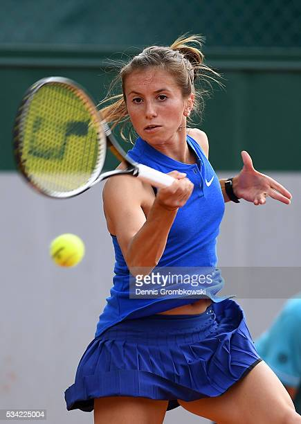 Annika Beck of Germany plays a forehand during the Women's Singles second round match against Kateryna Bondarenko of Ukraine on day four of the 2016...