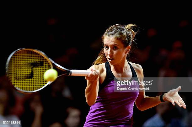 Annika Beck of Germany plays a forehand in her match against Camila Giorgi of Italy during Day 2 of the Porsche Tennis Grand Prix at PorscheArena on...
