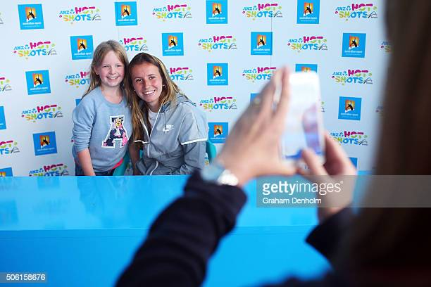 Annika Beck of Germany poses with a young fan at Autograph Island during day five of the 2016 Australian Open at Melbourne Park on January 22 2016 in...