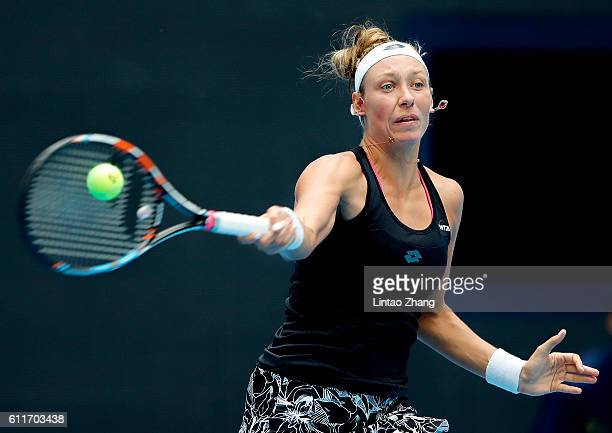 Annika Beck of Germany returns a shot against Belinda Bencic of Switzerland during the Women's singles first round match on day one of the 2016 China...