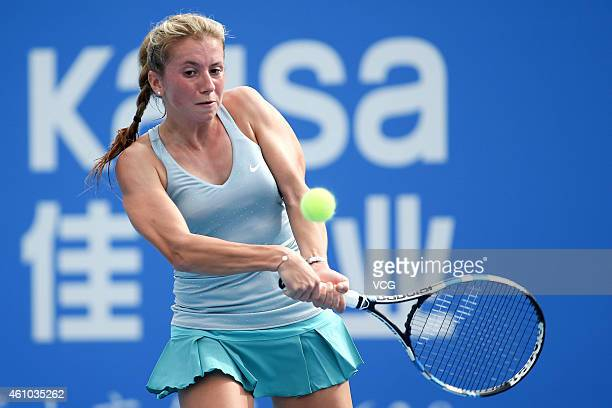 Annika Beck of Germany returns a shot against Simona Halep of Romania on day two of WTA Shenzhen Open at Longgang Sports Center on January 5 2015 in...