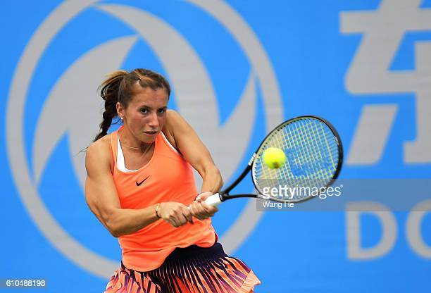 Annika Beck of Germany Returns a shot during the match against Johanna Konta of Britain on Day 2 of 2016 Dongfeng Motor Wuhan Open at Optics Valley...