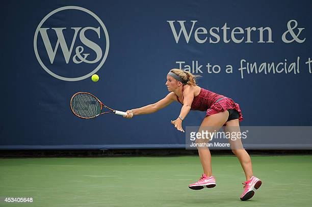 Annika Beck of Germany returns to Melanie Oudin during a match on day 1 of the Western and Southern Open on August 9 2014 in Cincinnati Ohio