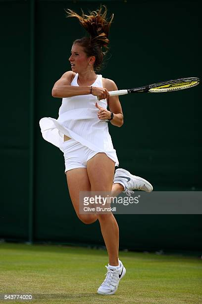 Annika Beck of Germany serves during the Ladies Singles first round match against Heather Watson of Great Britain on day four of the Wimbledon Lawn...