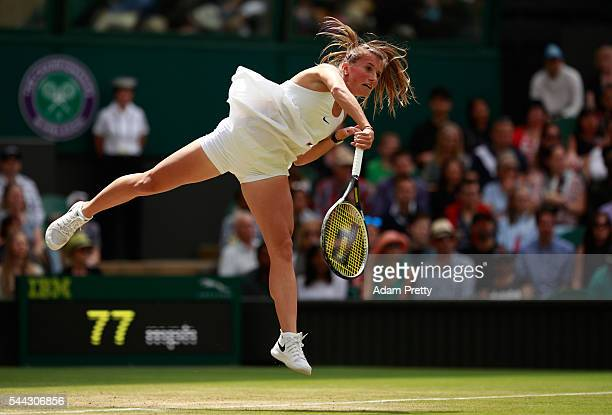 Annika Beck of Germany serves during the Ladies Singles first round match against Serena Williams of The United States on Middle Sunday of the...