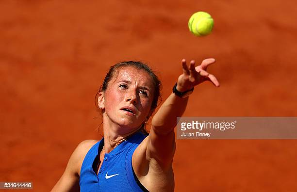Annika Beck of Germany serves during the Ladies Singles third round match against IrinaCamelia Begu of Romania on day six of the 2016 French Open at...