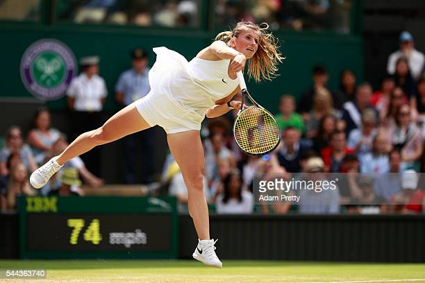 Annika Beck of Germany serves during the Ladies Singles third round match against Serena Williams of The United States on Middle Sunday of the...