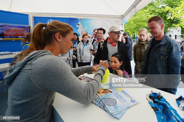 Annika Beck of Germany signs autographs during Day 2 of the Nuernberger Versicherungscup on May 18, 2014 in Nuremberg, Germany.