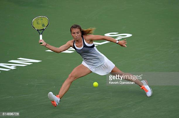 Annika Beck of Germany stretches to his a forehand against Bethanie MattekSands of the United States during day four of the BNP Paribas Open at...