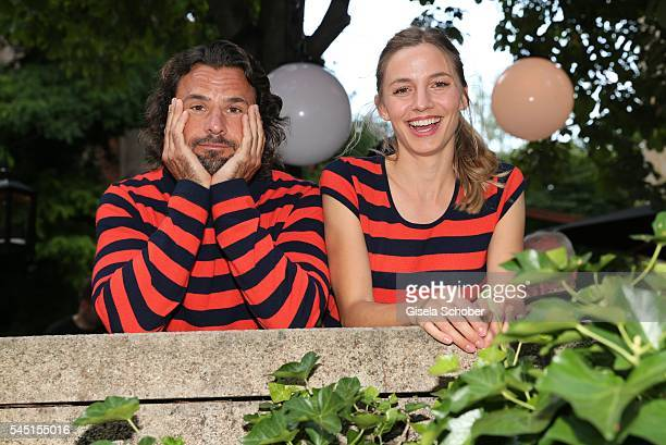 Annika Blendl and Stephan Luca wearing the same pullover of Iris von Arnim during the Iris von Arnim by Unuetzer launch party of the cashmere sneaker...
