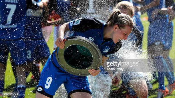 Annika Eberhardt of Hoffenheim II is sprayed with champagne while celebrating with the Bundesliga II trophy after victory in the match between 1899...