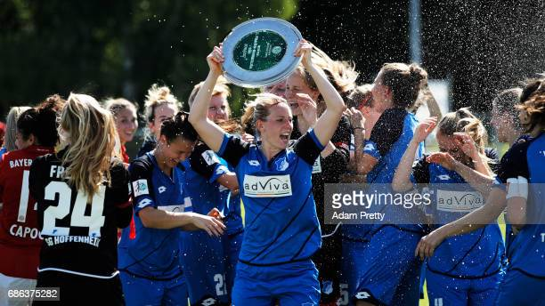 Annika Eberhardt of Hoffenheim II is sprayed with champagne while celebrating with the 2 Bundesliga Womens trophy after victory in the match between...