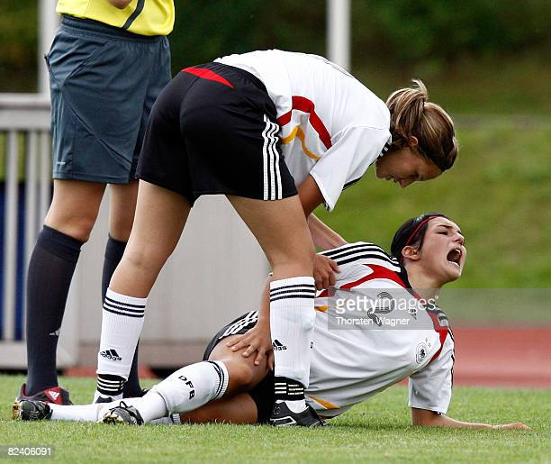 Annika Ernst of Germany must leave the pitch injured during the Women U15 international friendly match between Germany and Scotland at the Mons Tabor...