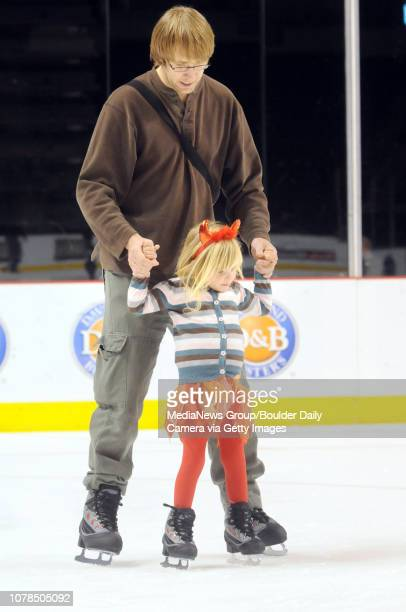 Annika Fellentz 3 1/2 skates with her father Chris for the first time during the Fall Fest at the Broomfield Event Center on Saturday October 25 2008...