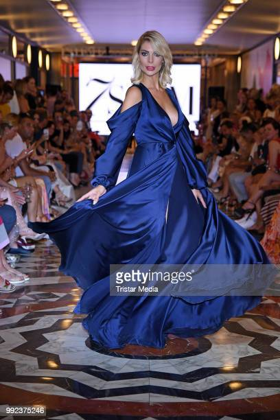 Annika Gassner walks the runway at the Fashion2Show show during the Berlin Fashion Week Spring/Summer 2019 at Quartier 206 on July 5 2018 in Berlin...