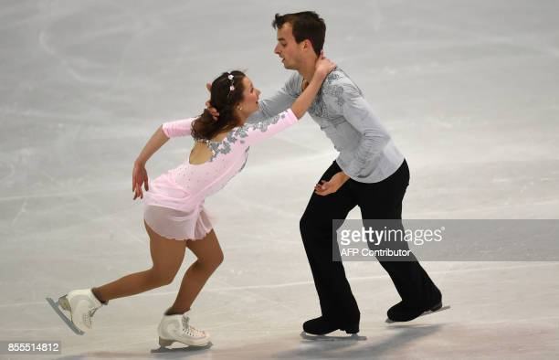 Annika Hocke and Ruben Blommaert from Germany perform during their pairs free skating program of the 49th Nebelhorn trophy figure skating competition...