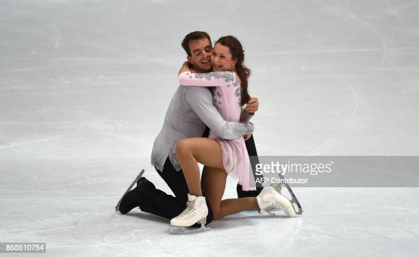 Annika Hocke and Ruben Blommaert from Germany react after their performance at the pairs free skating program of the 49th Nebelhorn trophy figure...