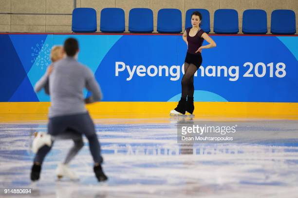 Annika Hocke of Germany watches Bruno Massot and Aliona Savchenko of Germany practice during Figure Skating training session ahead of the PyeongChang...