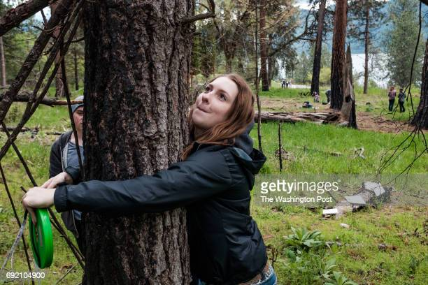 Annika Jacobson and Gavin Reasor measure a tree with their class from Lake City High School during a field trip to Farragut State Park in Idaho where...