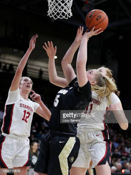 Annika Jank of the Colorado Buffaloes attempts to shoot a lay up past the defense of Ashten Prechtel and Lexie Hull of the Stanford Cardinal during...